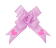 Pink ribbon bow with valentine. S on white with clipping path Stock Photo