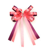 Pink ribbon bow on white background Stock Images
