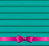 Pink Ribbon and Bow on Wooden Background for Birthday  Christ Royalty Free Stock Photography