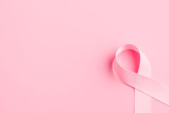 Pink ribbon breast cancer. On pink background Stock Image