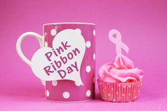 Pink Ribbon cupcake with message on coffee cup Stock Photos