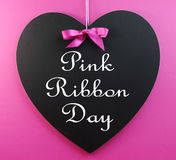Pink Ribbon Day message written on a heart shape blackboard Royalty Free Stock Photography