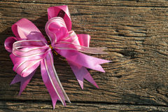 Pink ribbon decorated on wood textured royalty free stock photos