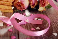 Pink ribbon in heart shape Royalty Free Stock Image