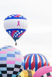 Pink ribbon hot air balloon taking off Stock Image