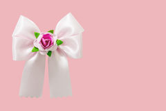 Pink ribbon on pink background Royalty Free Stock Photography