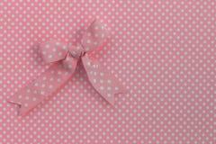 Pink ribbon on polka dots. royalty free stock image