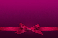 Pink ribbon on purple background Royalty Free Stock Image