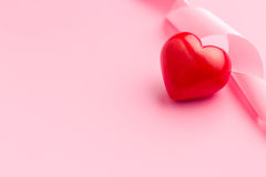 Pink ribbon with red heart Stock Photography