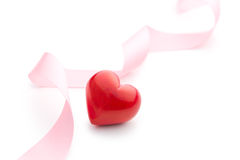 Pink ribbon with red heart Stock Image