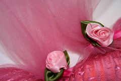 Pink Ribbon Roses. Closeup of pink ribbon roses and tulle stock photography