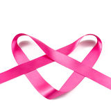 Pink ribbon in the shape of a heart Stock Photos