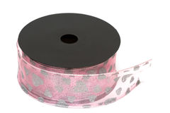 Pink ribbon on spool Royalty Free Stock Photos