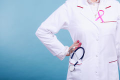 Pink ribbon with stethoscope on medical uniform. Stock Photography