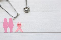Pink ribbon and stethoscope on white wooder background, Symbol of breast cancer in women, Health care concept royalty free stock photography