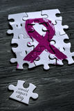 Pink ribbon and text world cancer day Royalty Free Stock Image