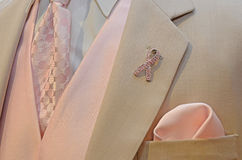Pink Ribbon on tuxedo lapel Royalty Free Stock Images