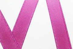 Pink ribbon on white card Stock Photo