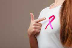 Pink ribbon on woman chest to support breast cancer cause Stock Photos