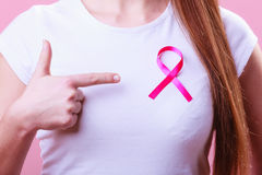 Pink ribbon on woman chest to support breast cancer cause Royalty Free Stock Photography