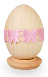 Pink ribbon on wooden egg Stock Photos