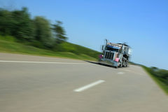 Pink Rig. Pink eighteen wheeler rig driving on a highway Royalty Free Stock Photos