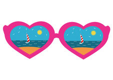 Pink-rimmed glasses with a heart, reflecting beach Royalty Free Stock Photos