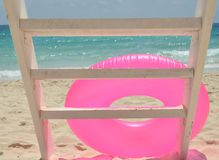 Pink ring on the beach Royalty Free Stock Photography