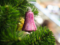 Pink ring bell hanging on Christmas tree Royalty Free Stock Image