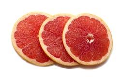 Pink ripe grapefruit slice on white isolated background. Half and slice of grapefruit isolated on white. stock photo