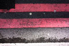Pink road markings on asphalt royalty free stock photography