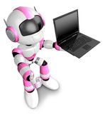 Pink Robot holding a laptop Royalty Free Stock Images