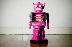 Pink robot Stock Images