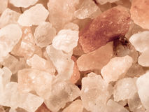 Pink rock salt crystals. Macro image of pink rock salt crystals Royalty Free Stock Image