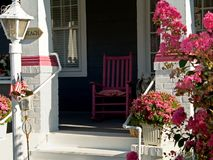 Pink Rocker. This is a shot of a pink rocker on a colorful porch Stock Images
