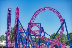 Pink roller coaster at the park royalty free stock photography