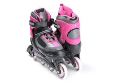 Pink roller skates isolated on white Stock Photo