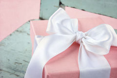 Closeup of pink gift box on wooden chair Stock Image
