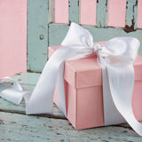 Pink present on a blue wooden chair Royalty Free Stock Image