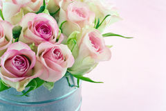 Pink roses in an old metal bucket Stock Photos