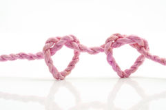 Pink rope heart shaped symbol Royalty Free Stock Photos