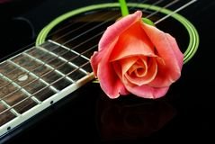 Free Pink Rose And Black Acoustic Guitar. Stock Images - 109474144