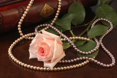 Pink Rose And Pearl Beads Stock Photos