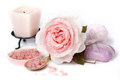 Pink rose with bath salt and candle Stock Photos