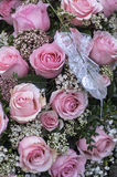 Pink rose blossom and baby's breath Royalty Free Stock Photos