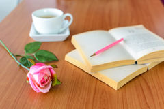 Pink rose with book and coffee Royalty Free Stock Image