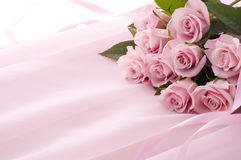 Pink rose bouquet. Rose bouquet on pink chiffon cloth Stock Photo