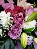 Pink rose bouquet. Bouquet with pink roses, white lilacs royalty free stock image