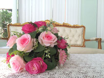 Pink rose bouquet on table Stock Image