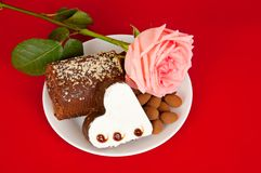 Pink rose and cake Stock Photo